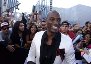 """Actor and singer Tyrese Gibson arrives at the LA Premiere of the """"Fast & Furious 6"""" at the Gibson Amphitheatre on Tuesday, May 21, 2013 in Universal City, Calif. (Dan Steinberg / Invision/AP)"""