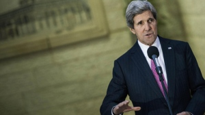 U.S. Secretary of State John Kerry makes a statement to the press after meeting with Palestinian President Mahmoud Abbas at the presidential compound in the West Bank city of Ramallah on Saturday, Jan. 4, 2014. (AP Photo/Brendan Smialowski, Pool)