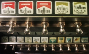 A cigarette vending machine in a bar in Montpelier, Vt. is seen on Monday, Oct. 13, 1997. (AP Photo/Toby Talbot)