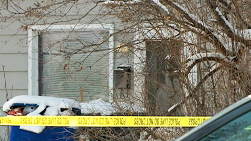 Police tape blocks off a home following a child's death in Saskatoon on Saturday, Jan. 4, 2014.