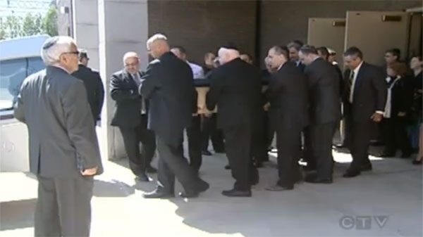 Pallbearers carry Ted Tevan's coffin to the hearse at his funeral Wednesday.