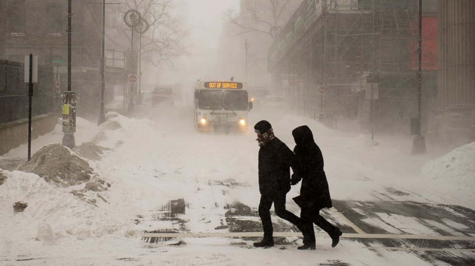 Pedestrians brave the blizzard conditions in Halifax on Friday, Jan. 3, 2014. The region is in the grip of unseasonably cold temperatures with heavy snow and high winds. (Andrew Vaughan / THE CANADIAN PRESS)