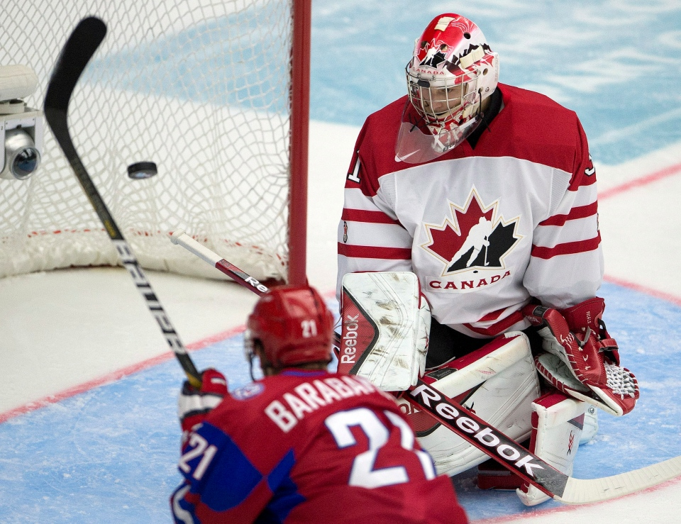 Russia forward Alexander Barabanov eyes the puck as Canada goaltender Zachary Fucale makes a save during second period Bronze Medal game action at the IIHF World Junior Hockey Championships in Malmo, Sweden on Sunday, Jan. 5, 2014. (Frank Gunn / THE CANADIAN PRESS)