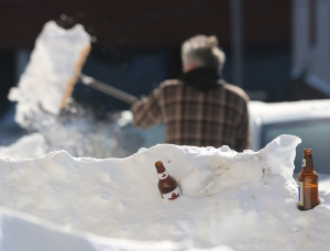 In this file photo, a man shovels out after a winter storm hit St.John's, N.L., on Jan. 5, 2014. (Paul Daly / THE CANADIAN PRESS)