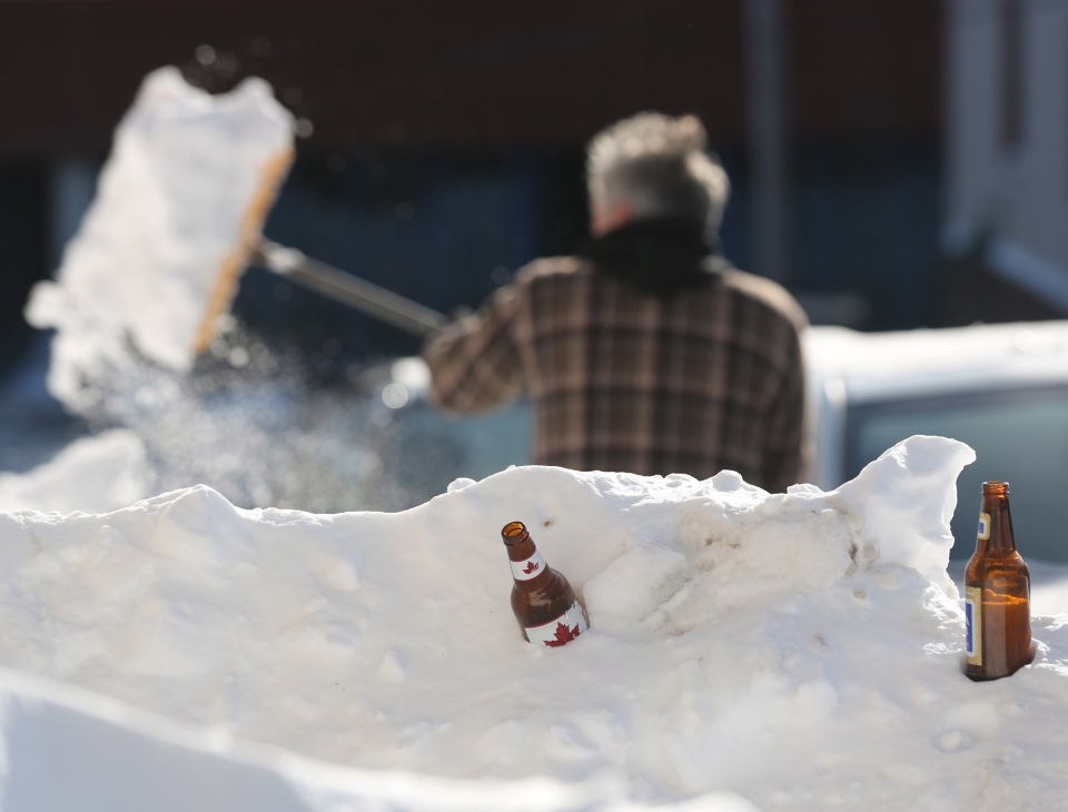 A man shovels out after a winter storm hit St.John's, N.L., on Jan. 5, 2014. (Paul Daly/THE CANADIAN PRESS)