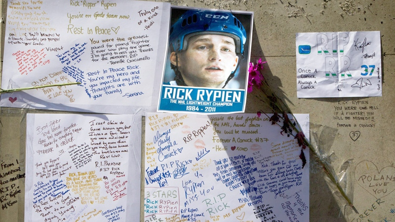Messages left by fans are pictured at a makeshift memorial to honour former Vancouver Canucks hockey player Rick Rypien outside Rogers Arena in Vancouver, B.C., on Wednesday, Aug. 17, 2011. (Darryl Dyck / THE CANADIAN PRESS)