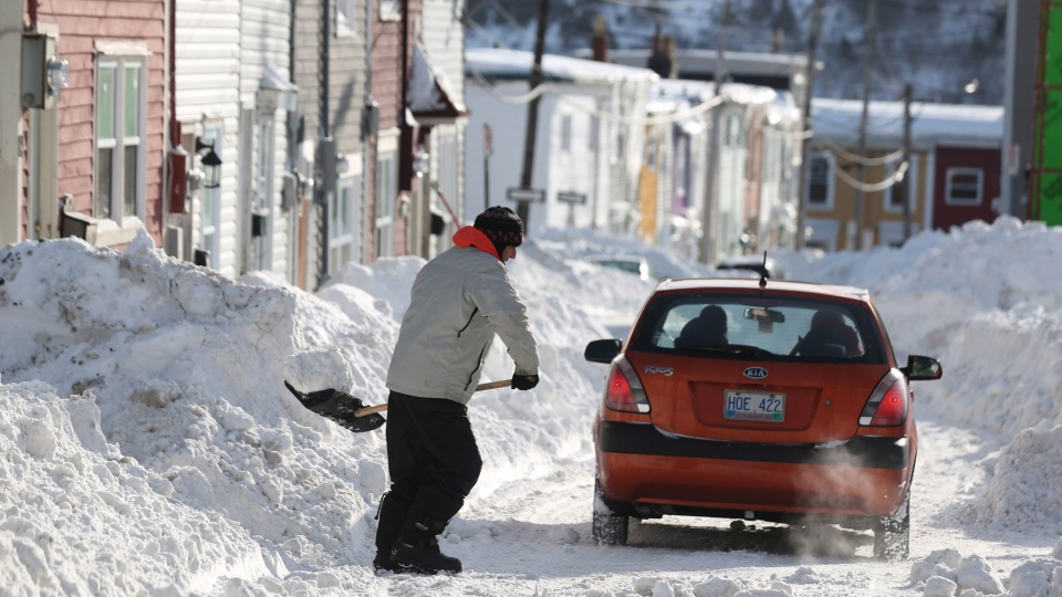 A man shovels out after a winter storm hit St.John's. N.L., Sunday, Jan.5, 2014. (Paul Daly / THE CANADIAN PRESS)