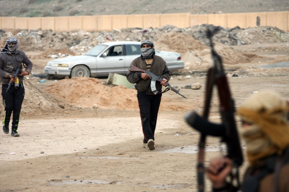 Gunmen patrol after clashes with Iraqi security forces in Fallujah, 65 kilometers west of Baghdad, Iraq, Sunday, Jan. 5, 2014. (AP)