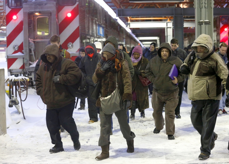 Commuters arrive at the La Salle Street commuter rail station as they experience temperatures well below zero and wind chills expected to reach 40 to 50 below in Chicago, Monday, Jan. 6, 2014. (AP / Charles Rex Arbogast)