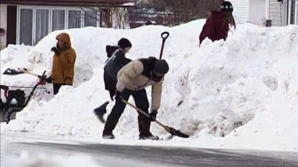 Residents in St. John's dig out after a major winter blast left thousands without power across N.L. on Monday, Jan. 6, 2013.