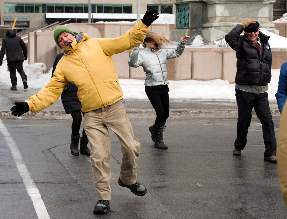 Pedestrians battle 90 km/h wind gusts as the city faces freezing rain, snow, and a rollercoaster temperature swing from 5C to -13C as winter continues its assault Monday, Jan. 6, 2014 in Montreal. (Ryan Remiorz / THE CANADIAN PRESS)