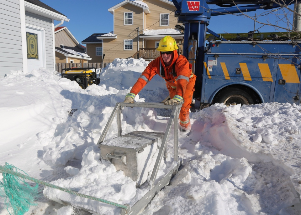 Linemen replace blown transformers as they attempt to return power to residential customers in St. John's, N.L., Monday, Jan. 6, 2014. (Paul Daly / THE CANADIAN PRESS)