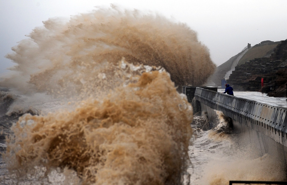 Waves crash onto the promenade between Fleetwood and Blackpool, as high tides and huge waves hit northwest England, Monday Jan. 6, 2014. (AP / PA, John Giles)