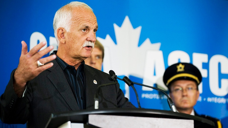 Minister of Public Safety Vic Toews speaks at a Canadian Boarder Services Agency press conference in Toronto on Thursday, Aug. 18, 2011.  (Aaron Vincent Elkaim / THE CANADIAN PRESS)