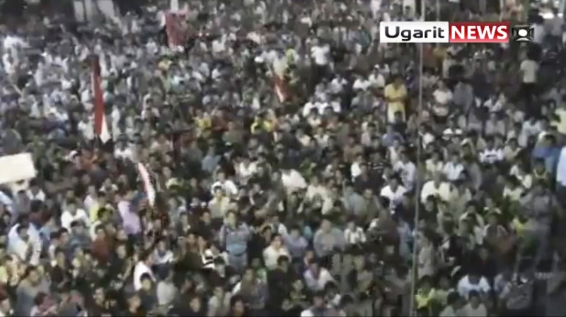 A large crowd reportedly gathered in the town of Rastan near Homs, during which people chant 'Rastan demands the execution of the president,' on on Wednesday Aug. 17, 2011. (Ugarit via APTN)