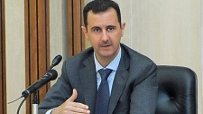 In this photo taken Wednesday, Aug. 17, 2011, released by the Syrian official news agency SANA, Syrian President Bashar Assad addresses a meeting for the central committee of the Baath party in Damascus, Syria. (AP / SANA)