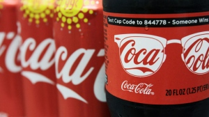 A variety of Coca-Cola cans and bottles are displayed on a counter at a local store in West Bath, Maine, Monday, Aug. 8, 2011, in this photo illustration. (AP Photo/Pat Wellenbach)
