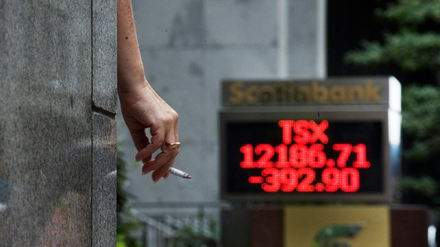 The numbers on the Scotiabank board on King Street in Toronto show the continued tumble of the TSX closing down 392.90 points on Thursday, Aug. 18 2011. (Aaron Vincent Elkaim / THE CANADIAN PRESS)