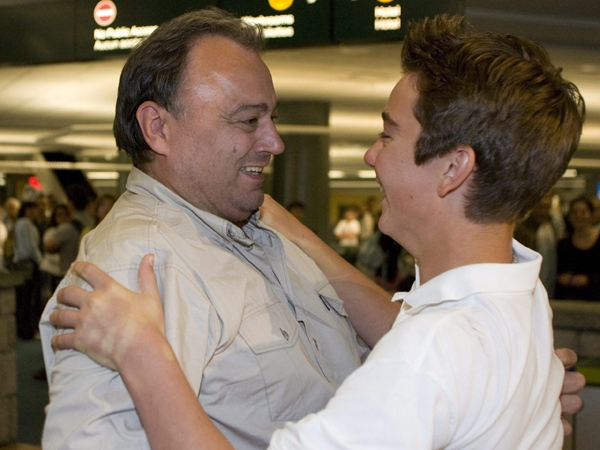 Michael Kapoustin greets his son Nicholas, 16-years-old, after arriving at Vancouver International Airport in Richmond, Sunday, July 6, 2008 . (Richard Lam / THE CANADIAN PRESS)