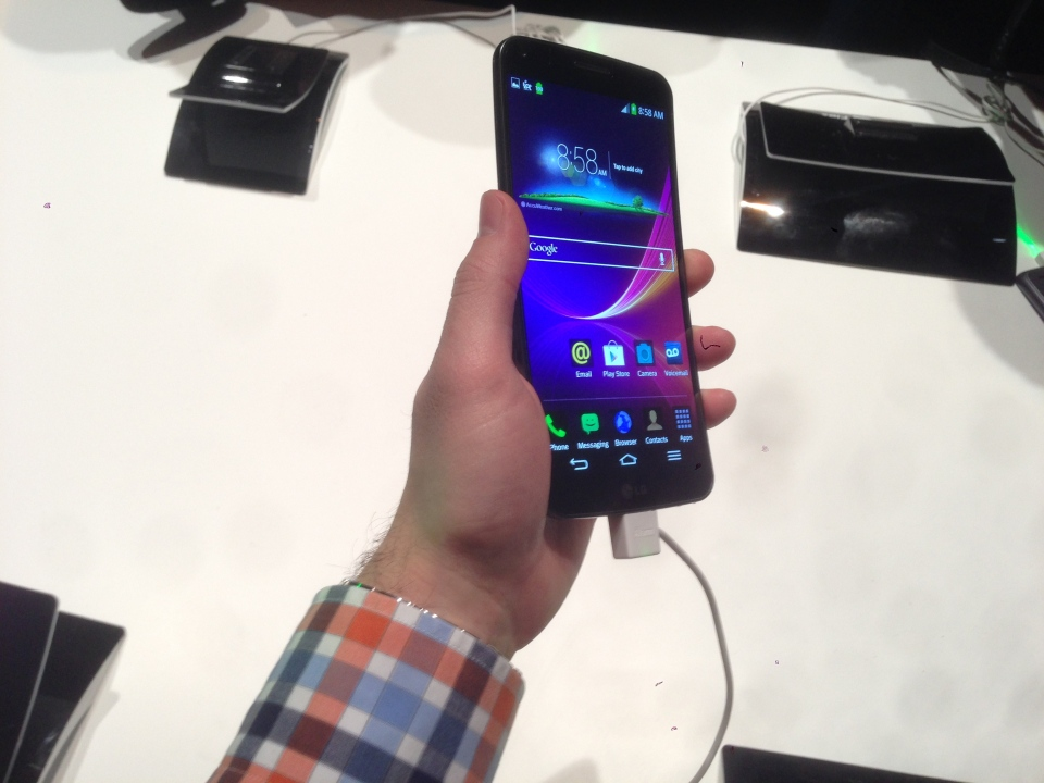Maurice Cacho holds the LG G Flex curved phone at the Consumer Electronics Show in Las Vegas on Monday, January 6,