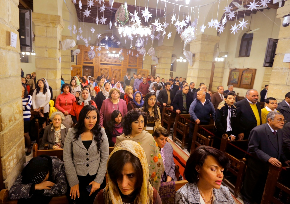 Egyptians celebrate Christmas Eve mass in the Coptic Orthodox Church of Virgin Mary in Cairo, Egypt, Monday, Jan. 6, 2014. (AP / Amr Nabil)