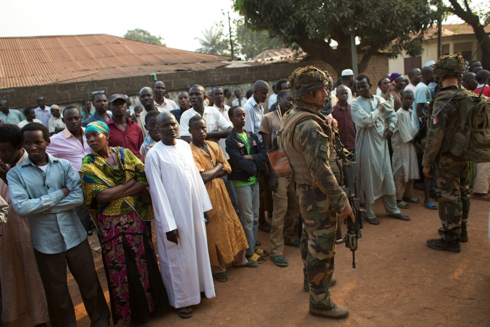 Muslim neighborhood residents gather outside the building where the commander of the Sangaris forces was meeting with leaders of the Muslim community, in the Kilometer 5 district of Bangui, Central African Republic, Monday, Jan. 6, 2014. (AP / Rebecca Blackwell)