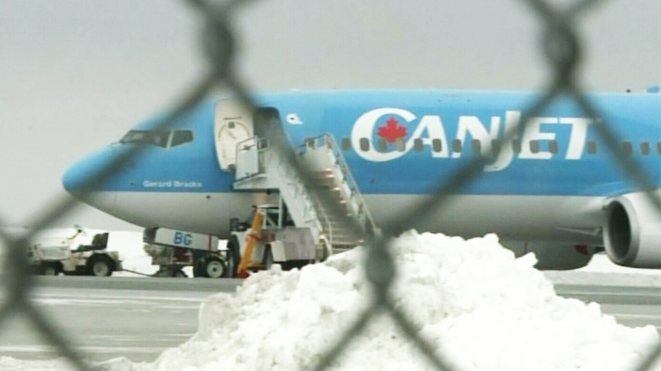 Hundreds of Montrealers returning home from Cuba found themselves stranded on a Fredericton runway for several hours Monday due to freezing rain on Monday, Jan. 6, 2013.