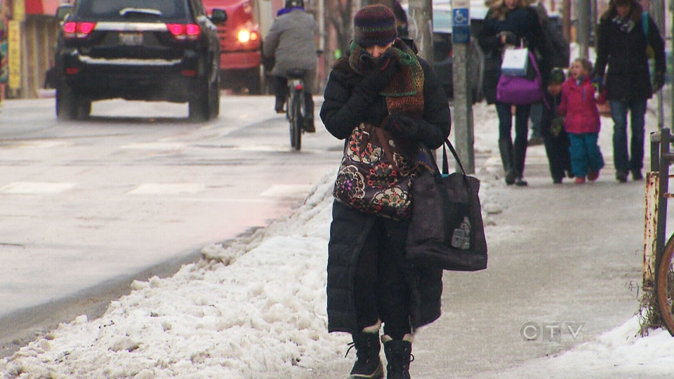 A resident bundles up as the GTA is set to enter another deep freeze with wind chills as low as -41 are expected overnight, on Monday, Jan. 6, 2014.