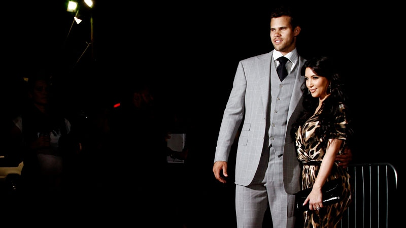 Kim Kardashian, right, and her fiance, NBA basketball player Kris Humphries, arrive at the Kardashian Kollection launch party in Los Angeles, Wednesday, Aug. 17, 2011. (AP / Matt Sayles)