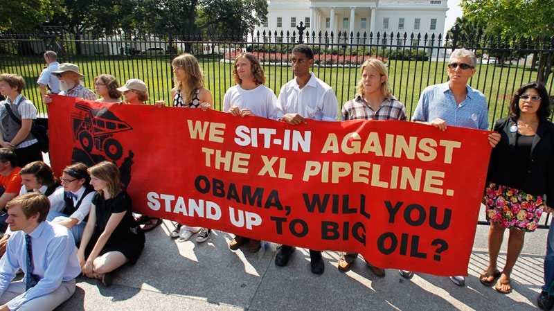 Protesters over a proposed pipeline to bring tar sands oil to the U.S. from Canada, gather in front of the White House in Washington, Saturday, Aug. 20, 2011. (AP / Manuel Balce Ceneta)