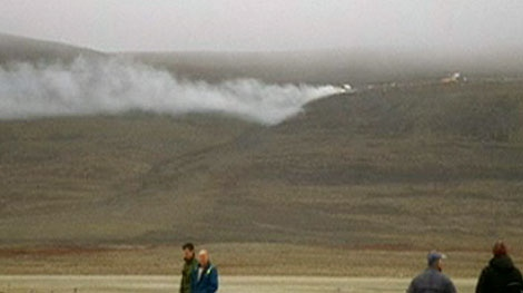 Smoke emerges from the hills of Resolute Bay, Nunavut, just moments after a plane crash Saturday, Aug. 20, 2011.