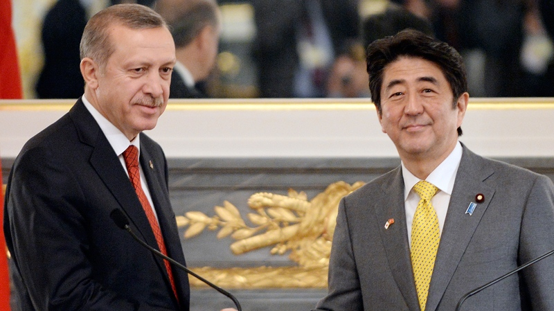 Turkish Prime Minister Recep Tayyip Erdogan, left, shakes hands with Japanese Prime Minister Shinzo Abe, right, at the end of their joint press announcement at the state guesthouse in Tokyo Tuesday, Jan. 7, 2014. (AP Photo/Toshifumi Kitamura, Pool)