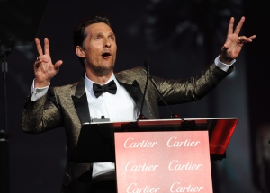 "Matthew McConaughey accepts the Desert Palm achievement award - actor for ""Dallas Buyers Club"" at the Palm Springs International Film Festival Awards Gala at the Palm Springs Convention Center on Saturday, Jan. 4, 2014, in Palm Springs, Calif. (Frank Micelotta / Invision / AP)"