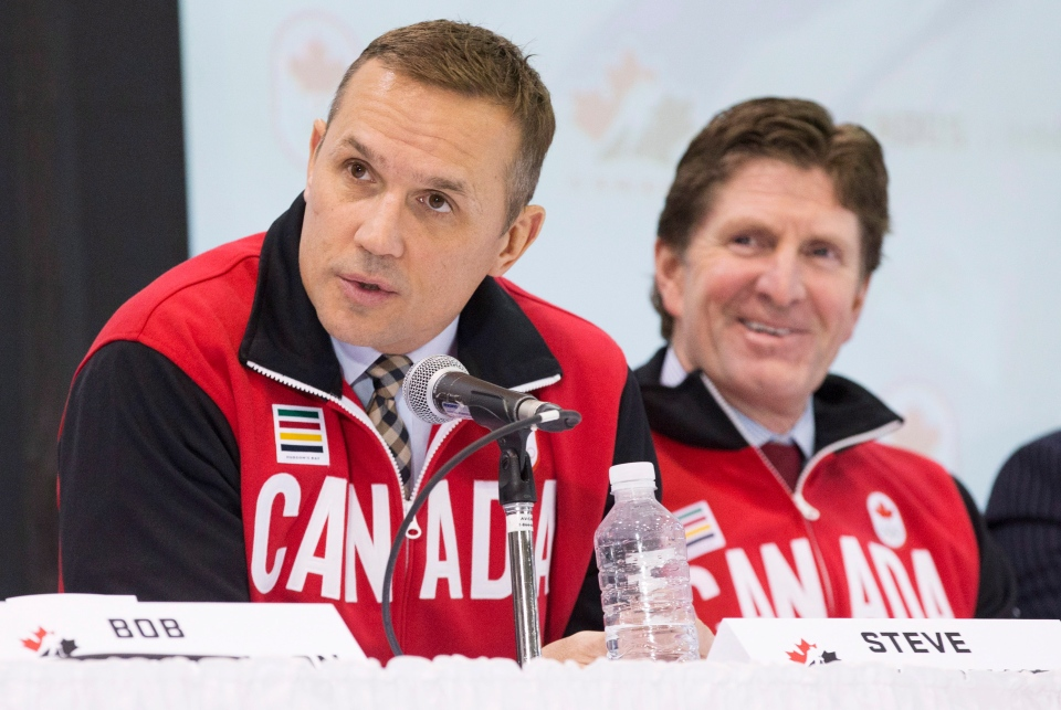 Team Canada Olympic hockey team Executive Director Steve Yzerman and head coach Mike Babcock, right, speak following the announcement of the team roster in Toronto, Tuesday Jan. 7, 2014. (Mark Blinch / THE CANADIAN PRESS)