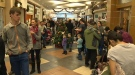 The line wrapped around the inside of Brentwood Village Mall on Tuesday, January 7, 2014.