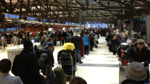 Hundreds of passengers in-line at the Ottawa Airport before dawn today. Some are here for a second or third day.