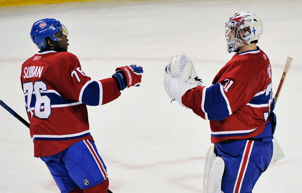 Montreal Canadiens' goaltender Carey Price, right, celebrates with teammate P.K. Subban after defeating the New York Rangers' in an NHL hockey game in Montreal, Saturday, February 8, 2011.THE CANADIAN PRESS/Graham Hughes