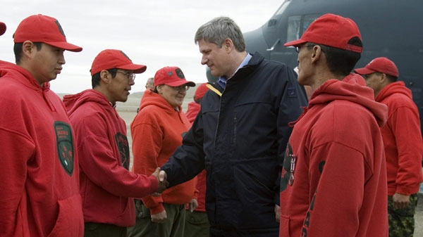 Prime Minister Stephen Harper is greeted by Arctic Rangers as he arrives in Resolute Bay, Nunavut, Friday August 10, 2007. The fatal crash of a jetliner in Resolute Bay on Saturday has cast a pall over Harper's annual Arctic tour scheduled for this week. THE CANADIAN PRESS/Fred Chartrand)