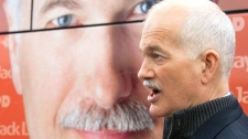 NDP Leaader Jack Layton responds to media questions as he stands by his campaign bus in Montreal, Thursday, April 14, 2011. (Jacques Boissinot / THE CANADIAN PRESS)