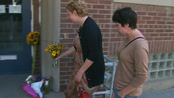 Mourners leave flowers on the front step of Jack Layton's Toronto home in condolence of Layton's passing Monday morning, Aug. 22, 2011.