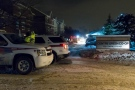 York Regional Police officers investigate a shooting outside a townhouse complex on Centre Street East in Richmond Hill early Wednesday, Jan. 8, 2014. (Tom Stefanac/CP24)