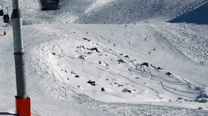 View taken Tuesday, Jan. 7, 2014 of French Alps ski resort of Meribel, and the rocks between the slopes where former seven-time Formula One champion Michael Schumacher injured his head during a ski accident. (AP / Claude Paris)