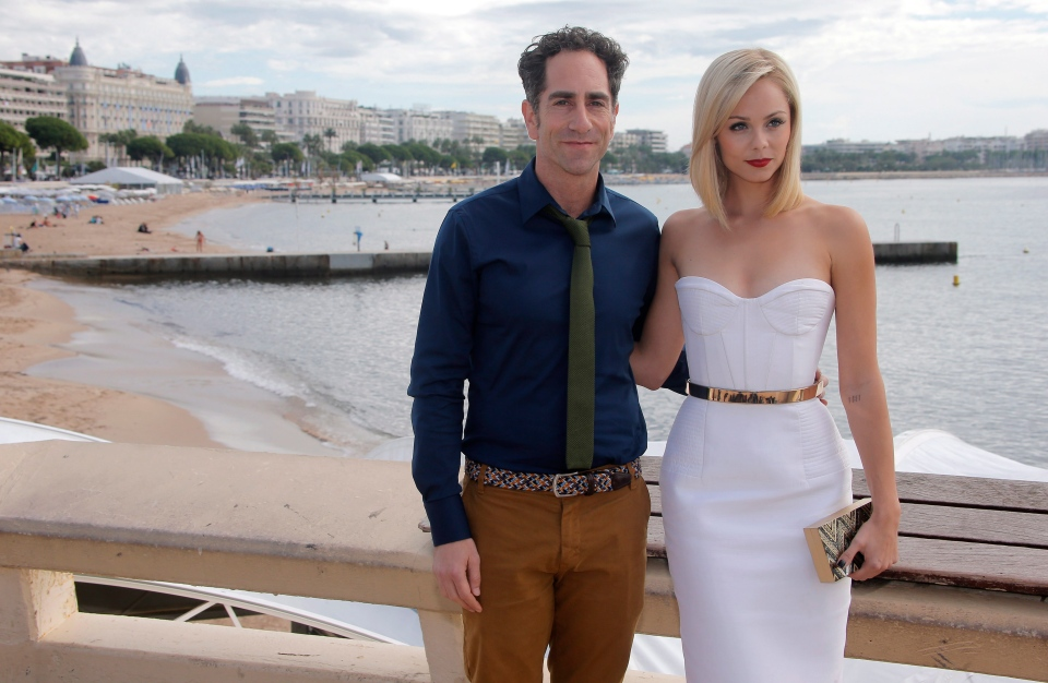 """Canadian actress Laura Vandervoort and executive producer J.B Sugar attend MIPCOM to promote the TV series """"Bitten"""", an adaptation of the Kelley Armstrong novel, in Cannes in October, 2013. (AP Photo/Lionel Cironneau )"""