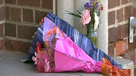 Flowers lie outside Jack Layton's constituency office at 221 Broadview Avenue in Toronto, Monday, Aug. 22, 2011.