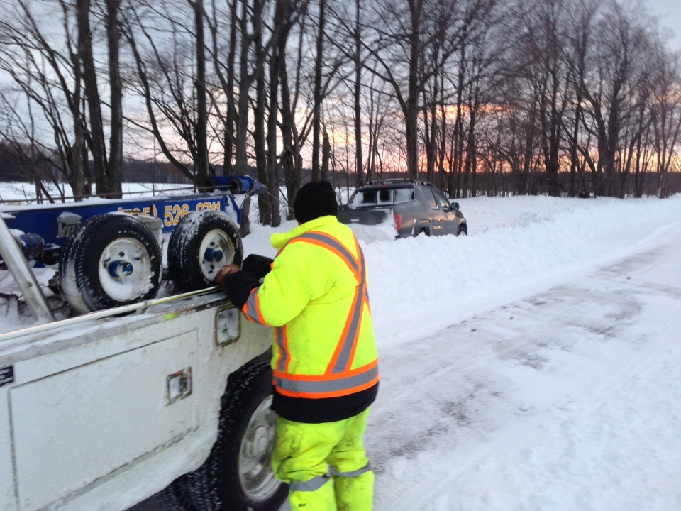 A tow truck is on the scene after a car gets stuck near Barrie, Ont. on Wednesday, Jan. 8, 2014. (Roger Klein / CTV Barrie)