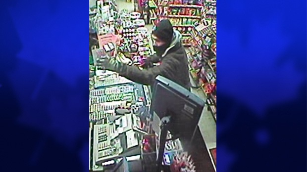 An image taken from surveillance video released by the London Police Service show a suspect sought in an alleged attempted robbery at the Lorne Avenue Mini Mart on Jan. 3, 2014.