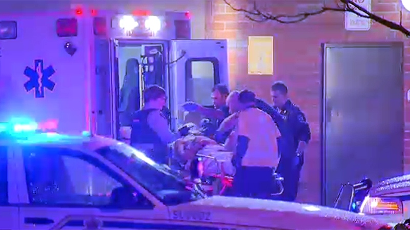 A man is loaded into an ambulance after he was shot inside a Surrey Mac's store Tuesday, Jan. 7, 2014. Police are still searching for a suspect in what they're saying was likely a targeted hit. (CTV)