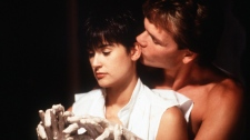 "In this image released by Paramount Pictures, Demi Moore, left, and Patrick Swayze are shown in a scene from ""Ghost."" (AP Photo/Paramount Pictures, file)"