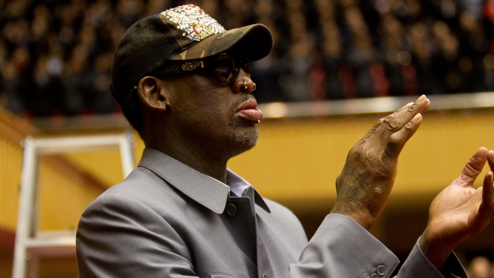 Dennis Rodman applauds from court side at an exhibition basketball game between U.S. and North Korean players at an indoor stadium in Pyongyang, North Korea on Wednesday, Jan. 8, 2014. (AP / Kim Kwang Hyon)