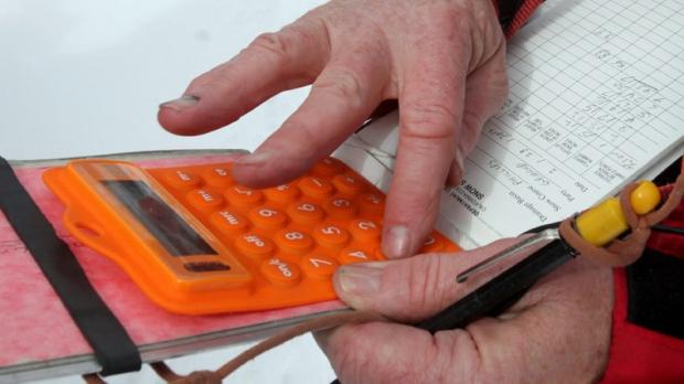 Frank Gehrke uses a calculator